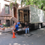 A film crew on break at Montague Terrace on Monday