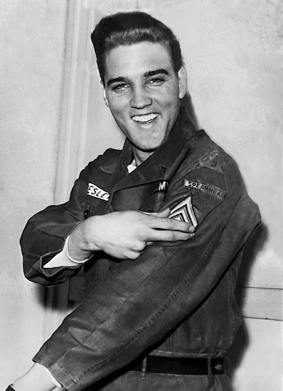 Elvis Presley smiles after he is promoted to army sergeant at the U.S. Army Unit's maneuver headquarters in Grafenwoehr, Germany, on Feb. 11, 1960. Presley went into the Army in 1958 and was shipped out for Europe at the Brooklyn Army Terminal. AP Photo
