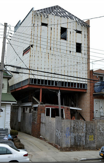 This is the eyesore that used to be located at 1882 E. 12th St. Eagle file photo by Rob Abruzzese