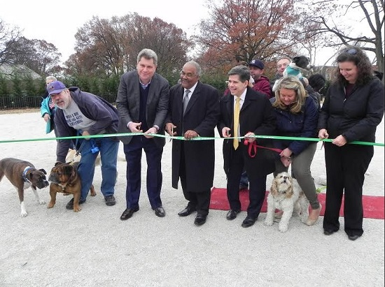 Brooklyn Parks Commissioner Kevin Jeffrey (center) joins dog owner Rick Gimeranez, Assemblymember Alec Brook-Krasny, Councilmember Vincent Gentile, Brook-Krasny's chief of staff Kate Cucco, and Community Board 10 District Manager Josephine Beckmann (left to right) at the ribbon cutting. Eagle photos by Paula Katinas