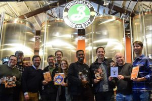 The Brooklyn Brewery hosted a Holiday Book Market on Monday night. Attendees had the opportunity to meet their favorite beer and spirit authors and buy their books, while sharing a beer. Pictured from left: John Holl, Lew Bryson, Giancarlo Annese, Brooklyn Brewery owner Steve Hindy, James Rodewald, Sarah Annese, Brewmaster Garrett Oliver, Jeremy Cowan, Jeff Cioletti and Ben Keene. Eagle photos by Rob Abruzzese