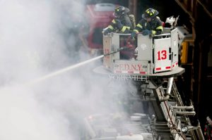 According to New York Mayor Bill de Blasio and FDNY Commissioner Daniel Nigro, New York City's Fire Department is on pace to have its busiest year on record. AP Photo/John Minchillo, File