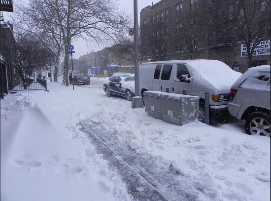 Snow covered sidewalks and cars on 18th Avenue in Bensonhurst. Eagle photo by Paula Katinas