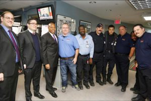 Brooklyn Borough President Eric Adams joins some of the employees of Midwood Ambulance Service at their main dispatch facility and corporate office in Gravesend as he recognizes them as the first honoree of Brooklyn's Community Businesses, a series he launched to honor local businesses with a commitment to their communities. Photo: Kathryn Kirk/Brooklyn BP's Office