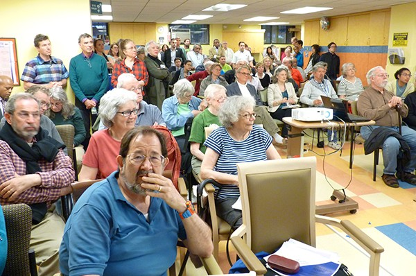 A stand-room-only crowd takes in the details of the Fortis plan. Photo by Mary Frost