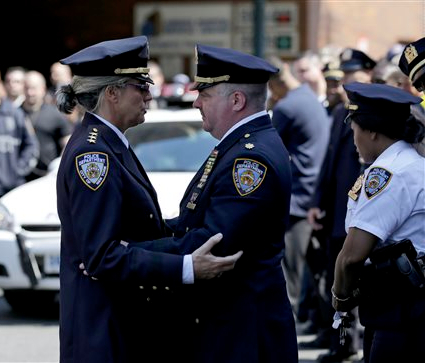 Plainclothes officers like Brian Moore have a role in the NYPD. AP Photo/Seth Wenig
