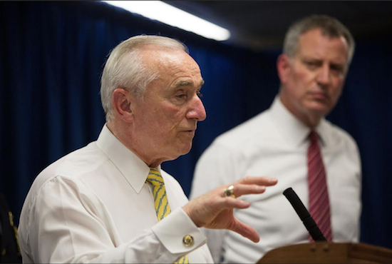 New York City Police Commissioner William Bratton, left, speaks during a news conference at the 44th Precinct station house in New York on June 10. This week, Bratton and New York City police officials provided the first in-depth look at a new policing strategy they say will put more beat cops in neighborhood precincts to improve the relationship between officers and the communities they serve. AP Photo/Kevin Hagen