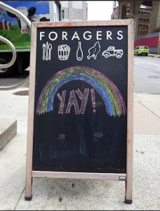 The sign outside of Foragers Market on Front Street in DUMBO celebrated Friday's Supreme Court ruling. Photo by Mary Frost