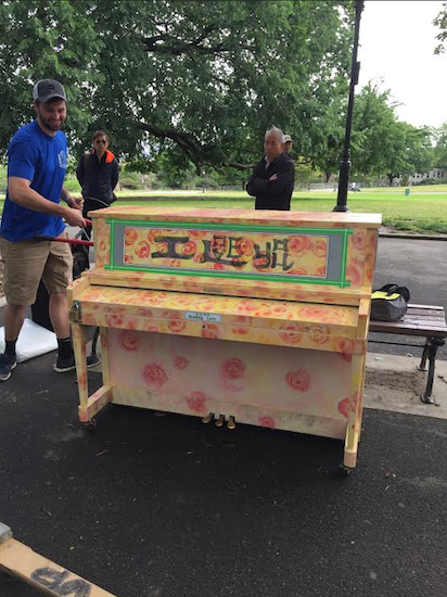 The Sing for Hope piano is moved into place in Sunset Park and is ready for anyone who wants to play. Photo courtesy Sunset Park BID