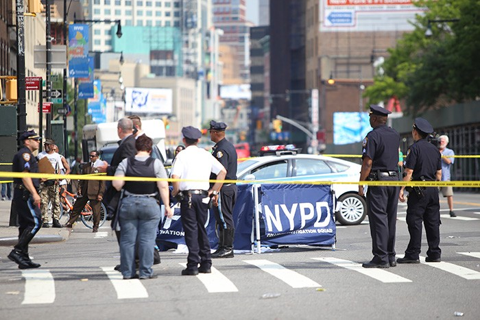 NYPD's Collision Investigation Squad works the scene. AKatzPhotos