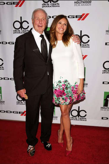 """In this Oct. 21, 2013 file photo, Brooklyn native Jerry Weintraub, left, and Julia Roberts arrive at the 17th Annual Hollywood Film Awards Gala in Beverly Hills, Calif. Weintraub, the dynamic producer and manager who pushed the career of John Denver and produced such hit movies as """"Nashville"""" and """"Ocean's Eleven,"""" died Monday of cardiac arrest in Santa Barbara, Calif. He was 77. Photo by John Shearer/Invision/AP, File"""