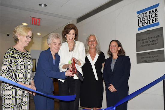 President of the New York City Bar Association Debra Raskin (second from left) and Chief Judge Carol Bagley Amon (center) help cut the ribbon to officially open the City Bar Justice Center on Tuesday, with Lynn Kelly (left), Hon. Lois Bloom (second from right) and Nancy Rosenbloom (right). Eagle photos by Rob Abruzzese