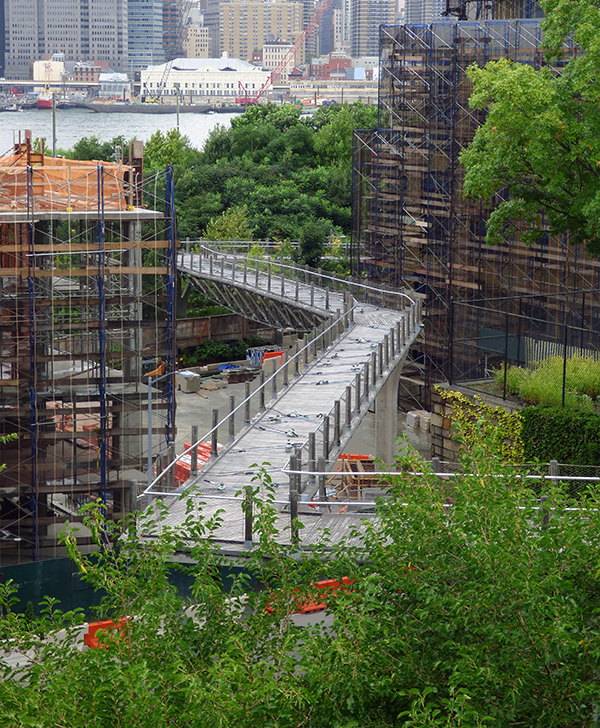 Bouncy Squibb Park Bridge, which connects Brooklyn Heights to Brooklyn Bridge Park, has been closed for an entire year.   Photo by Mary Frost