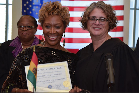 Justice Evelyn J. Laporte (left) was presented with a certificate by Supervising Judge Amanda White during the Kings County Family Court Hispanic Heritage Month Celebration this past Thursday. Hon. Jacqueline D. Williams is in the background. Eagle photos by Rob Abruzzese