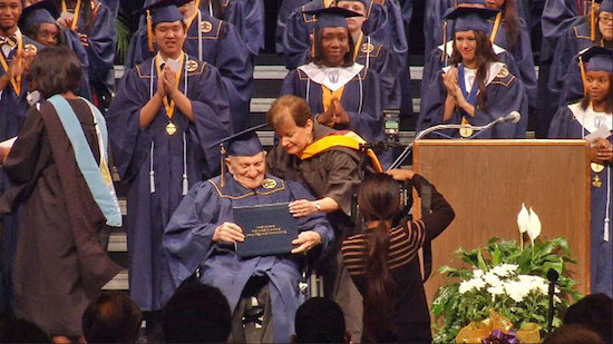 Bonnie Sandler presents her father, Brooklyn native Jack Koolik, with his Honorary HS Diploma at age 90 during Darnell-Cookman Middle/High School graduation ceremony in Jacksonville, Florida. Photos courtesy of WJXT NewsJax4.