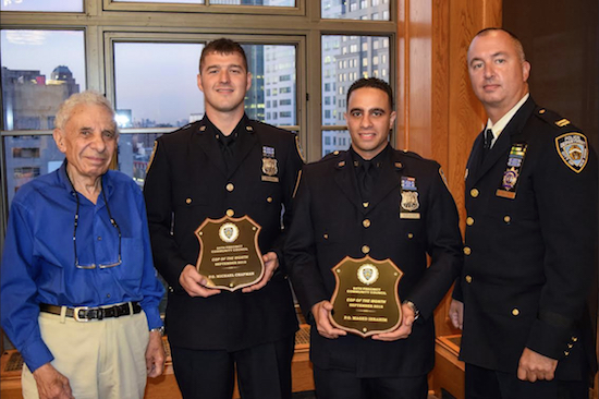 Officers Michael Chapman (second from left) and Maged Ibrahim (second from right) were honored as Cops of the Month by Leslie Lewis (left), president of the 84th Precinct Community Council, and Capt. Sergio Centa for their work in helping to reduce crime in Brooklyn Bridge Park. Eagle photos by Rob Abruzzese.