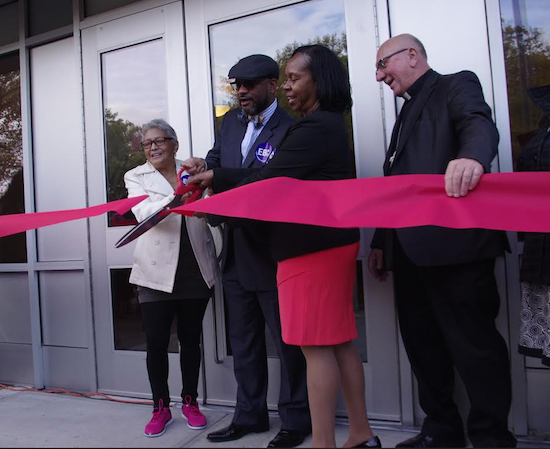 Pictured cutting the ribbon on Redwood Senior Living's residence on Schenk Ave. in East New York are (from left) Eudosia Rodriguez, Rev. David K. Brawley, Olivia Wilkins and Bishop David Benke. Eagle photos by Francesca N. Tate