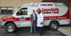 Steven R. Korf, president and chief executive officer (left), and Dr. Charles Lawrence, chairman of Emergency Medicine, at Interfaith Medical Center show off the hospital's new FDNY/EMS certified ambulance. Photo courtesy of Interfaith Medical Center