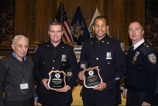 Officers John Condon (second from left) and Donovan Hunt (second from right) were honored as Cops of the Month by the 84th Precinct Community Council for all the work they've done in the pPrecinct community. Also pictured are Community Council President Leslie Lewis (left) and Deputy Inspector Sergio Centa. Eagle photos by Rob Abruzzese