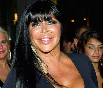 """Angela """"Big Ang"""" Raiola visited the Summer Stroll on 3rd street fair in Bay Ridge in 2014, appearing at Casa Calamari with owner Leo Lykourezos, meeting fans and selling bottles of her wine. Eagle file photo by Paula Katinas"""