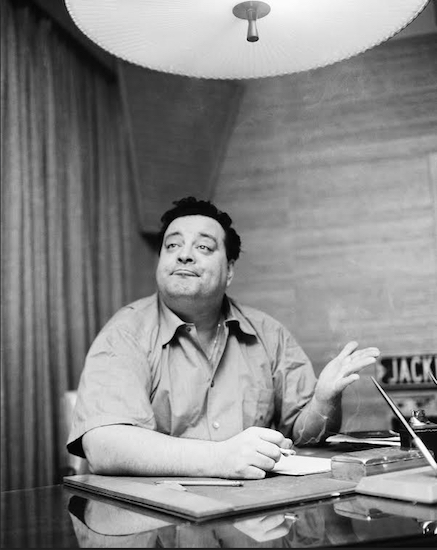 Comedian Jackie Gleason gestures at news conference in January, 1956 in New York. AP Photo/John Rooney