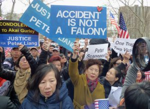 Ten to 15,000 protesters, the vast majority Asian American, poured into Cadman Plaza Park in Downtown Brooklyn on Saturday to support NYPD Officer Peter Liang. Photos by Mary Frost