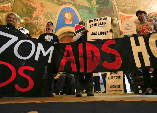 AIDS activists rally in the War Room at the Capitol on Monday in Albany. AP Photo/Mike Groll
