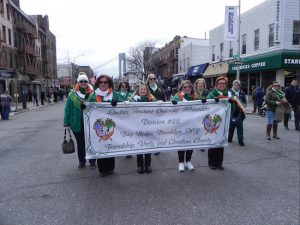 Members of the Ladies Ancient Order of Hibernians (Division 22) proudly display their banner. Eagle photos by Paula Katinas