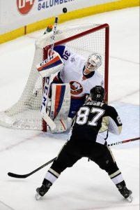 Rookie Jean-Francois Berube makes one of his 33 saves Tuesday night in Pittsburgh against Sidney Crosby as the Islanders picked up a big point in an eventual 2-1 shootout loss to the playoff-hopeful Penguins. AP photo