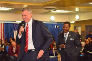 Mayor Bill de Blasio and Councilmember Mathieu Eugene presided over the town hall. Photo courtesy of Eugene's office