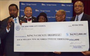 Councilmember Mathieu Eugene (left), state Sen. Jesse Hamilton (second from left) and other officials present a check to King's County Hospital officials. Photo courtesy of Eugene's office