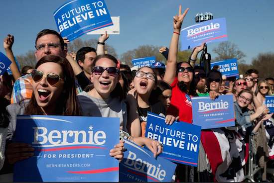 Supporters cheer as Democratic presidential candidate Bernie Sanders speaks during a campaign rally in Prospect Park on Sunday. AP Photo/Mary Altaffer