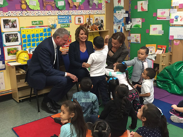 House Democratic Minority Leader Nancy Pelosi (center) visited Brooklyn on Wednesday to tour a pre-K program at P.S. 123 in Bushwick with Congresswoman Nydia Velazquez, Mayor Bill de Blasio and Department of Education officials. Photo courtesy of the office of Nancy Pelosi