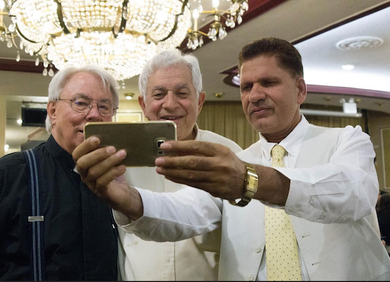 An Abrahamic selfie: Having fun was another vital part of Tuesday's iftar. Here, Fr. Michael Perry, New York State Democratic District Leader Jacob Gold and Javed from the NYPD's 70th Precinct enjoy each other's company. Eagle photo by Francesca N. Tate