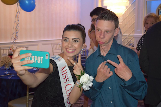 Miss Copper City Ashley Davis poses for a photo with one of the teens who attended the Kiwanis Club of 86th Street and Bath Beach's Dream Prom in Bensonhurst on Wednesday. Eagle photos by Rob Abruzzese