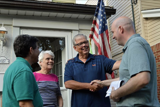 District leader candidate Chris McCreight (right) and Councilmember Vincent Gentile (left) talk to a Dyker Heights couple while campaigning earlier this month. McCreight says he has knocked on 14,000 doors of voters during the campaign. Photo courtesy of McCreight's campaign