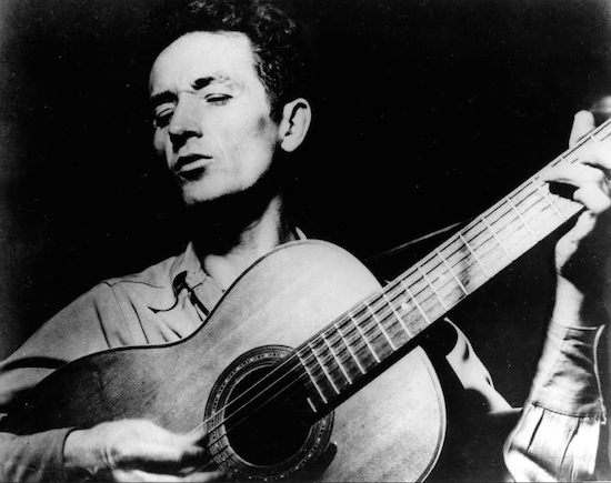 American troubadour Woody Guthrie playing his guitar. AP Photo/File
