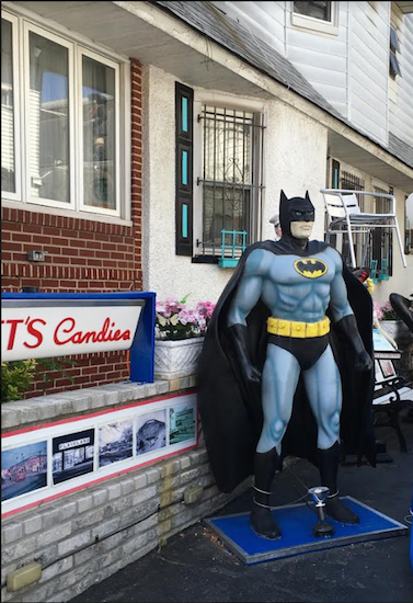 The Caped Crusader stands among a crew of fiberglass figures at the Statue House in Bensonhurst. Eagle photos by Lore Croghan