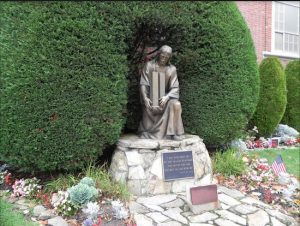 Parishioners at Saint Ephrem Catholic Church in Dyker Heights commissioned this statue of Jesus Christ lovingly holding the Twin Towers and had it erected in a garden outside the church as a tribute to the parishioners killed on Sept. 11. Eagle photo by Paula Katinas
