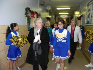 Schools Chancellor Carmen Fariña is welcomed by cheerleaders as she arrives for a town hall at McKinley Intermediate School in Bay Ridge in 2014. She is holding another town hall in District 20 on Oct. 25.  Eagle file photo by Paula Katinas
