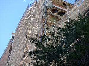 Demolition continued at the former Long Island College Hospital (LICH) site in Cobble Hill on Thursday following an incident on Wednesday when falling bricks injured two workers. Photo by Mary Frost