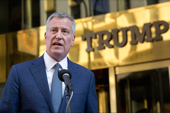 New York Mayor Bill de Blasio holds a news conference in front of Trump Tower following a meeting with President-elect Donald Trump on Wednesday in Manhattan. AP Photo/Mark Lennihan