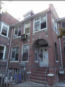 In August, the Dept. of Buildings ordered this two-family Dyker Heights home evacuated after local officials said inspectors found more than 30 people living there. Eagle file photo by Paula Katinas