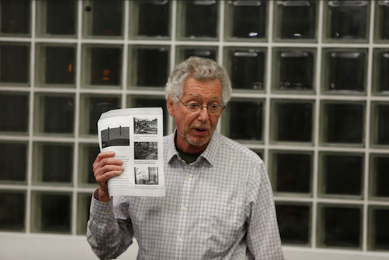 CUNY Professor Emeritus of biomedical and mechanical engineering Sheldon Weinbaum holds up a chart from Curbed San Francisco that shows methods used to anchor building such the Millennium Tower. Eagle photos by Andy Katz