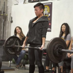 Rachel Hsiung, a product designer in Brooklyn, practicing for last year's Iron Maidens weightlifting competition.  Photo courtesy of Rachel Hsiung