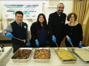 From left: Thomas Neve, Ting Ting Fu, Rev. El-Yateem and Rose Masyr help serve the meal. Eagle photos by Arthur De Gaeta