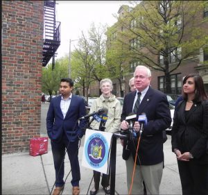 State Sen. Marty Golden (at podium) says he will not vote for the state budget if it cuts funding to senior citizen programs. Assemblymember Nicole Malliotakis (to his right) is also fighting to save the funding. Eagle file photo by Paula Katinas