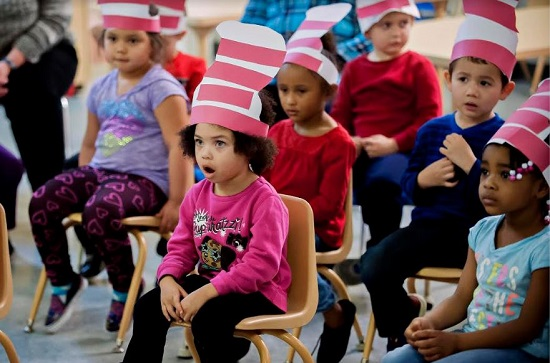 Mila Turner, center, 3, reacts during a Read Across America Day event at Foundry Christian Community Center on March 2 in Bowling Green, Kentucky. The event also celebrated the birthday of author Dr. Seuss. Bac Totrong/Daily News via AP