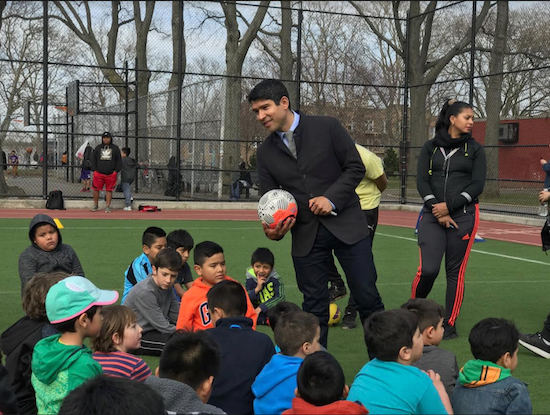 City Councilmember Carlos Menchaca speaks to students at one of the school sites he helped to spearhead. Photo courtesy of Carlos Menchaca