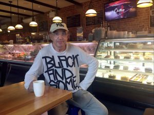 Michael Rubinsteyn, co-owner of the Efes Cafe and Bakery, poses for a photo on Friday, July 7, inside his business located in Brighton Beach. Rubinsteyn, 68, emigrated to the U.S. from Russia 40 years ago. New York City's Russian community has mixed emotions about the first meeting between President Donald Trump and Russian President Vladimir Putin. AP Photo/Steve Peoples